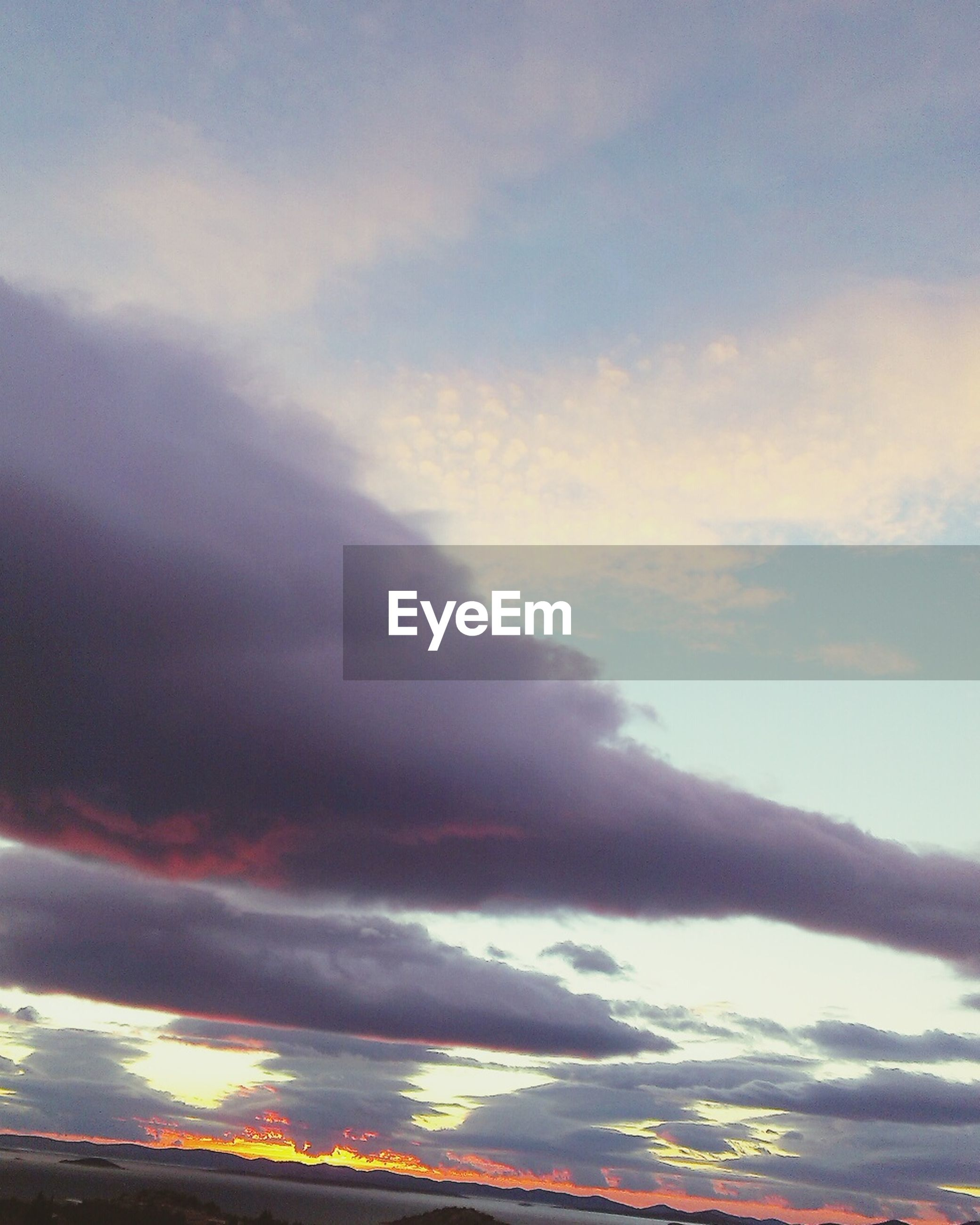 sky, cloud - sky, low angle view, cloudy, scenics, sunset, beauty in nature, tranquility, cloud, nature, tranquil scene, dramatic sky, idyllic, cloudscape, outdoors, weather, dusk, no people, overcast, rainbow