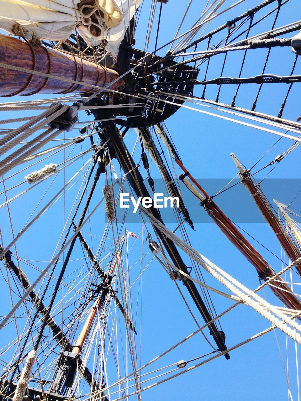 Directly Below Shot Of Masts Against Clear Sky