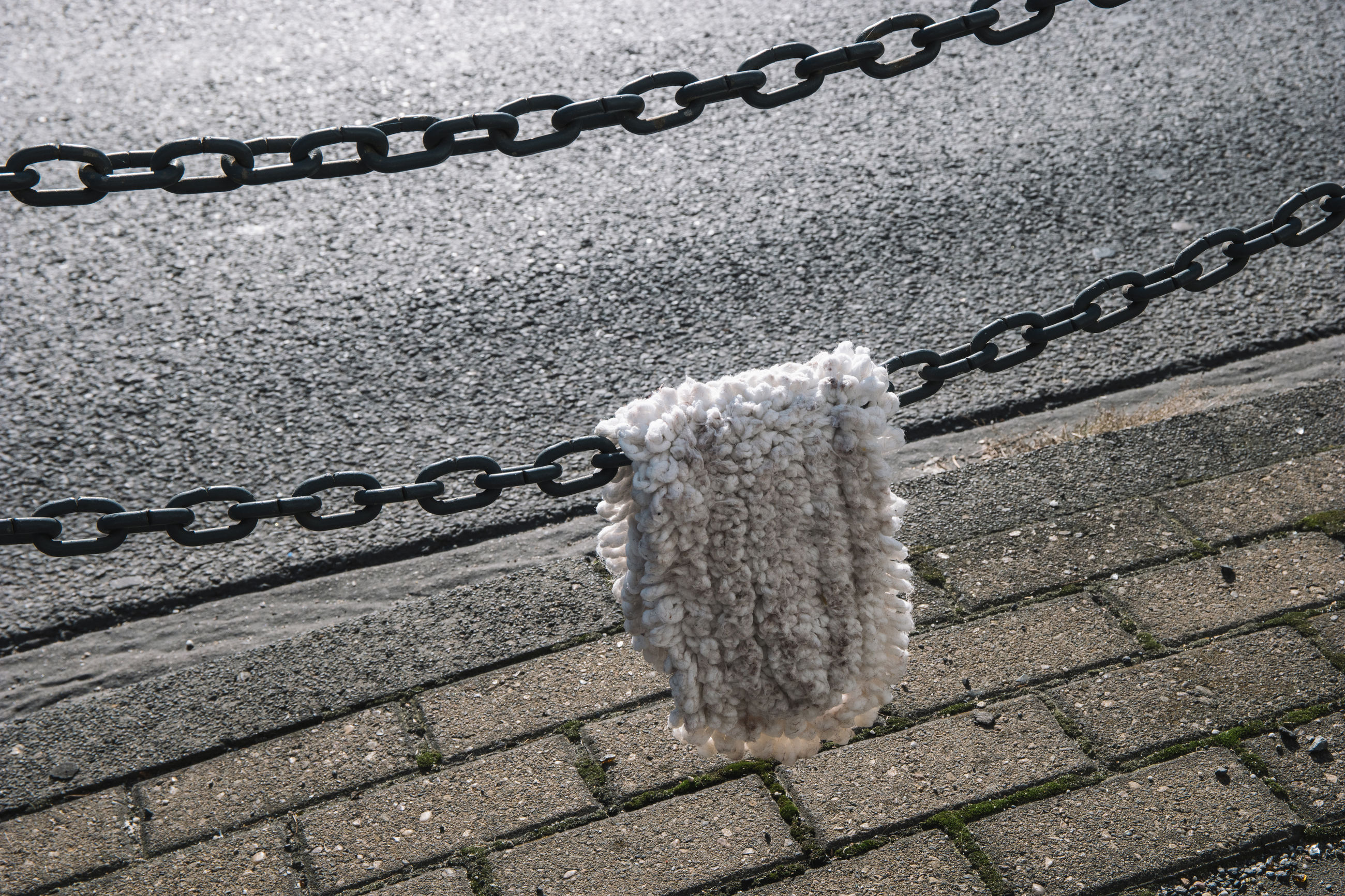 High angle view of doormat hanging on chain at beach