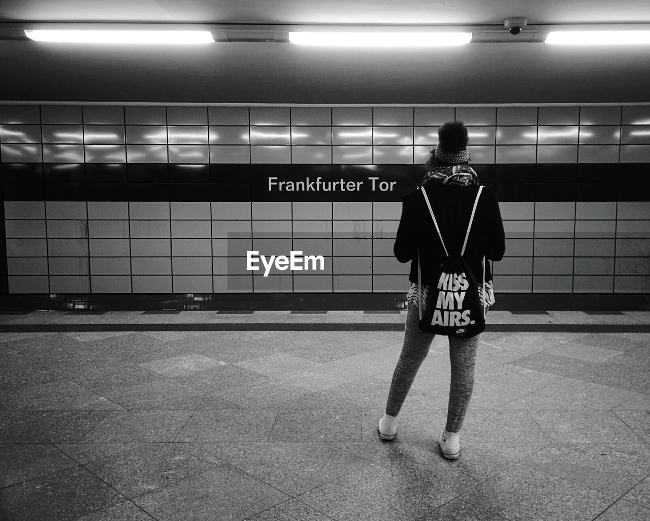 illuminated, full length, text, real people, communication, tile, subway station, one person, indoors, men, adult, people