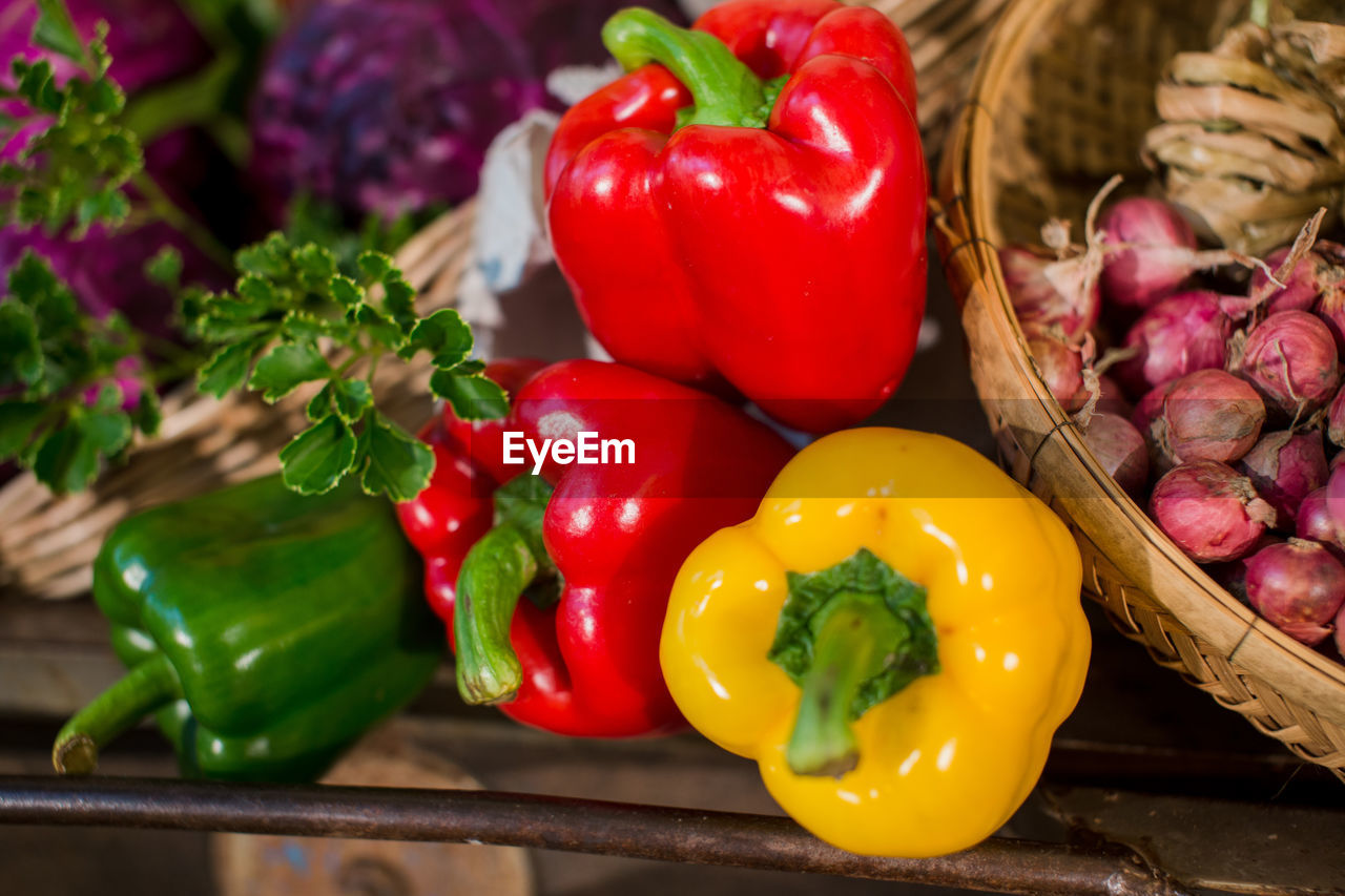 vegetable, food and drink, food, freshness, bell pepper, pepper, healthy eating, red, yellow, wellbeing, no people, close-up, red bell pepper, still life, basket, yellow bell pepper, spice, raw food, plant, green color, paprika