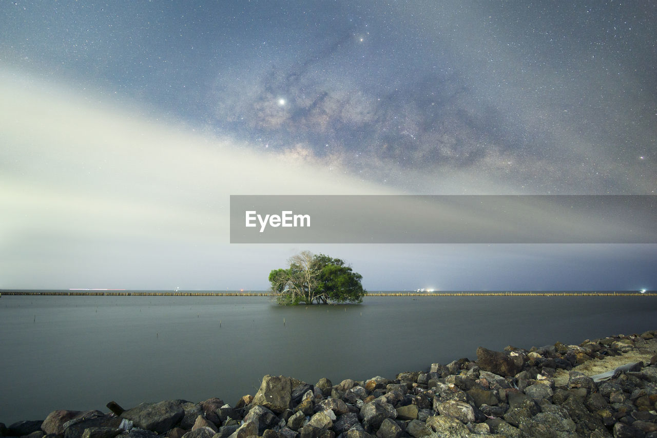 sky, scenics - nature, beauty in nature, water, tranquil scene, rock, tranquility, star - space, nature, sea, rock - object, solid, night, idyllic, no people, astronomy, cloud - sky, horizon, space, horizon over water, outdoors