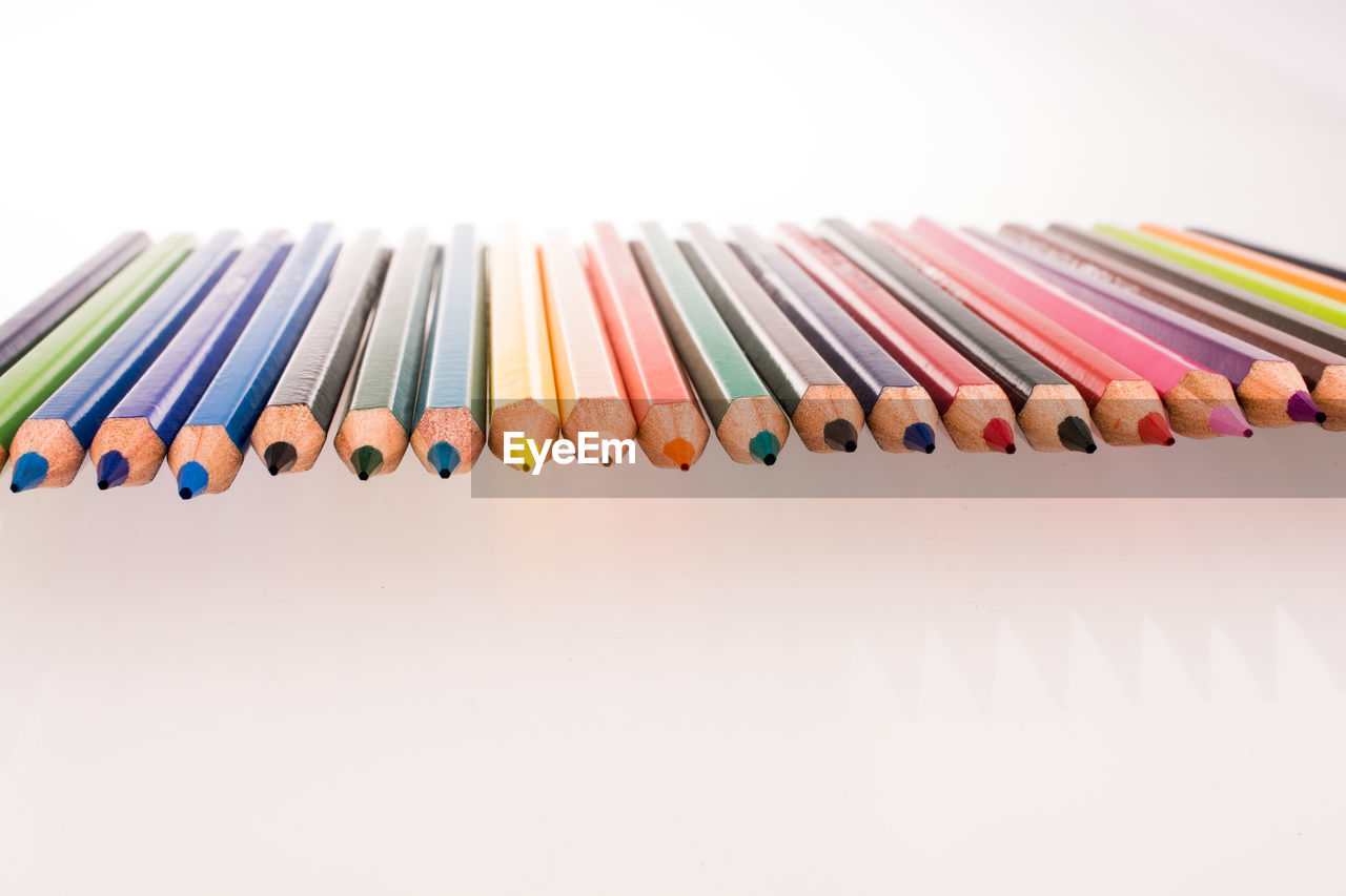 multi colored, white background, studio shot, indoors, choice, pencil, variation, still life, writing instrument, close-up, colored pencil, side by side, large group of objects, art and craft, collection, no people, arrangement, craft, creativity, copy space, art and craft equipment, variety
