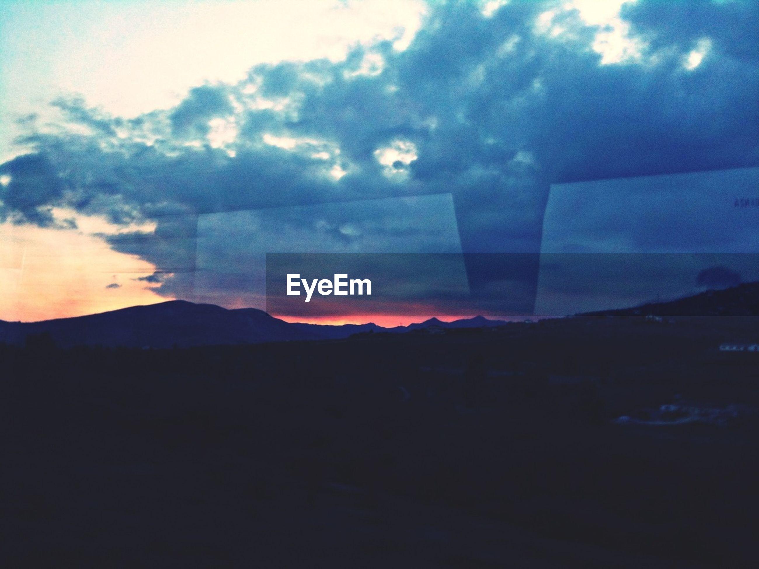sky, sunset, scenics, cloud - sky, landscape, silhouette, tranquility, tranquil scene, beauty in nature, nature, cloud, idyllic, cloudy, mountain, dusk, dark, dramatic sky, outdoors, non-urban scene, sunlight