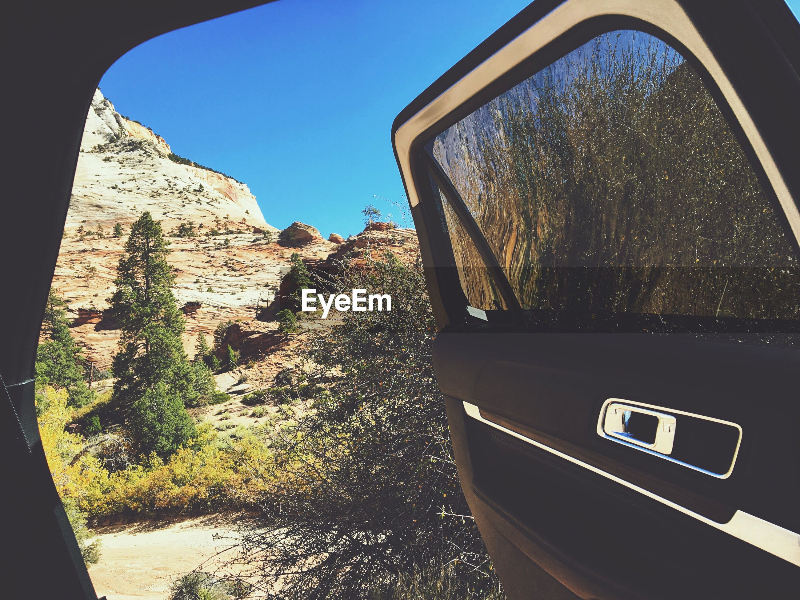 transportation, car, sky, land vehicle, window, vehicle interior, clear sky, mode of transport, car interior, close-up, day, outdoors, no people, vehicle mirror