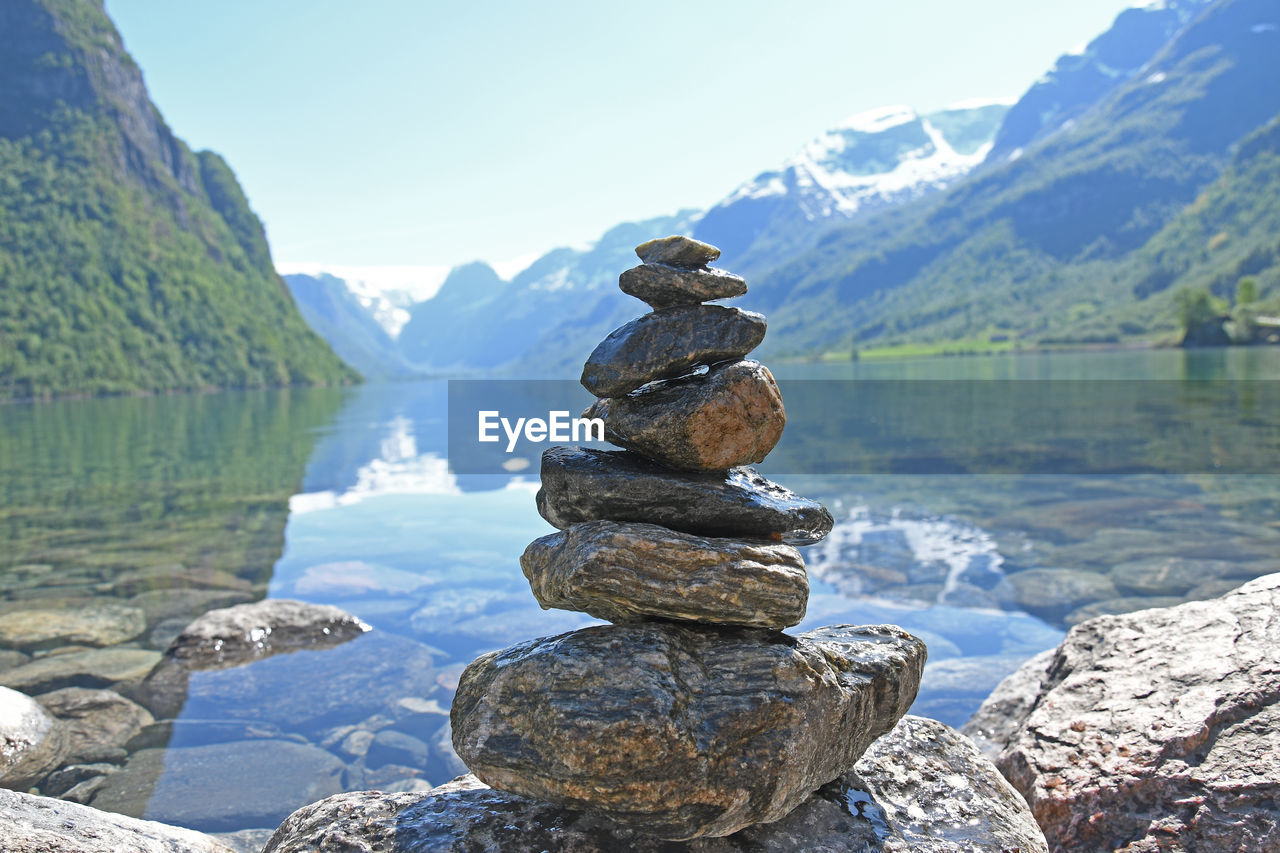 rock, stack, solid, water, rock - object, balance, beauty in nature, tranquility, mountain, stone - object, lake, nature, tranquil scene, zen-like, scenics - nature, sky, no people, non-urban scene, day, outdoors, pebble