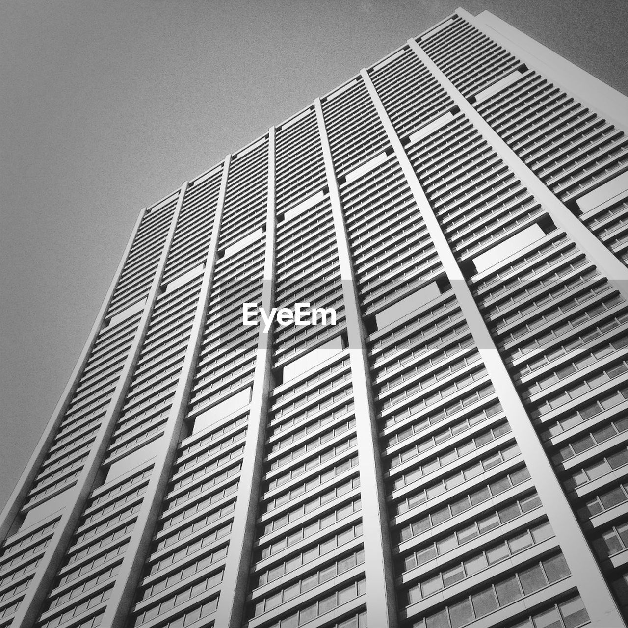 architecture, low angle view, building exterior, built structure, modern, no people, outdoors, day, city, skyscraper, clear sky, sky