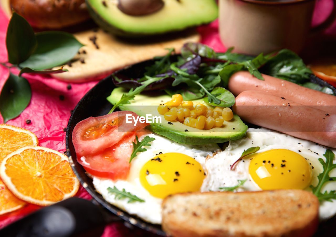 food, food and drink, freshness, healthy eating, wellbeing, indoors, close-up, fruit, ready-to-eat, vegetable, egg, still life, selective focus, meat, no people, citrus fruit, yellow, plate, serving size, slice, egg yolk, breakfast