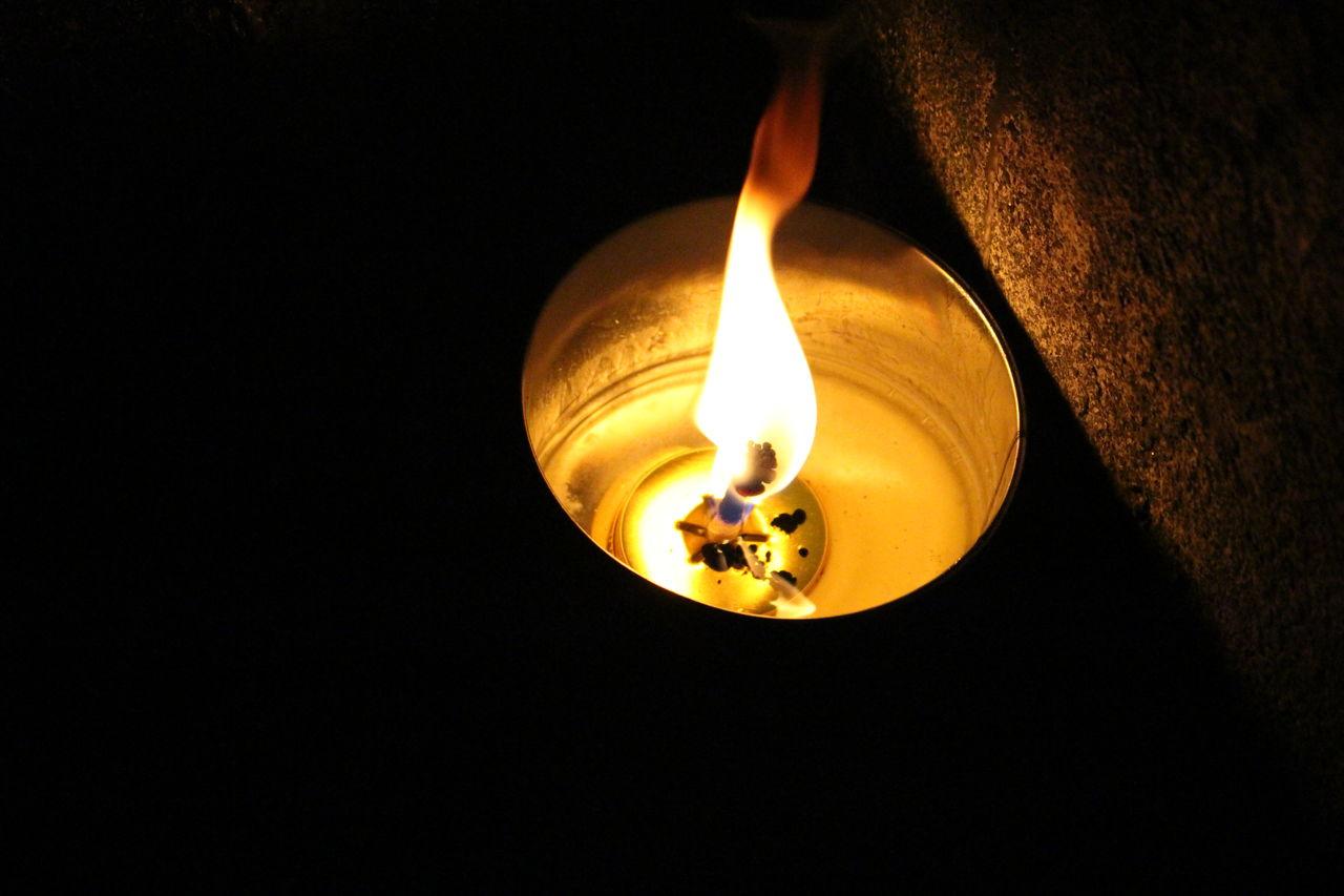 Close-Up Of Lit Diya At Night