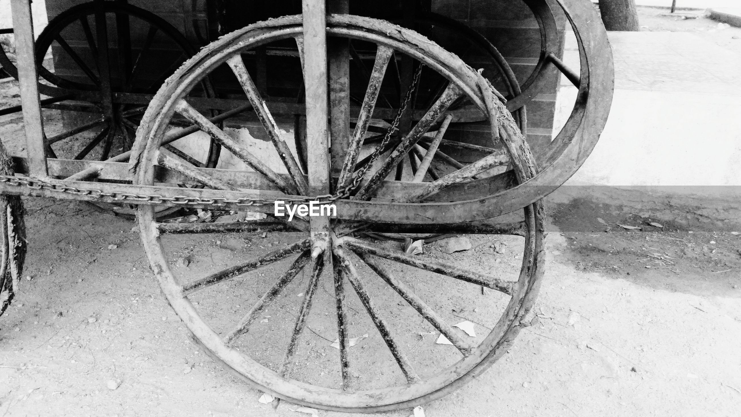 Close-up of cropped wheeled cart