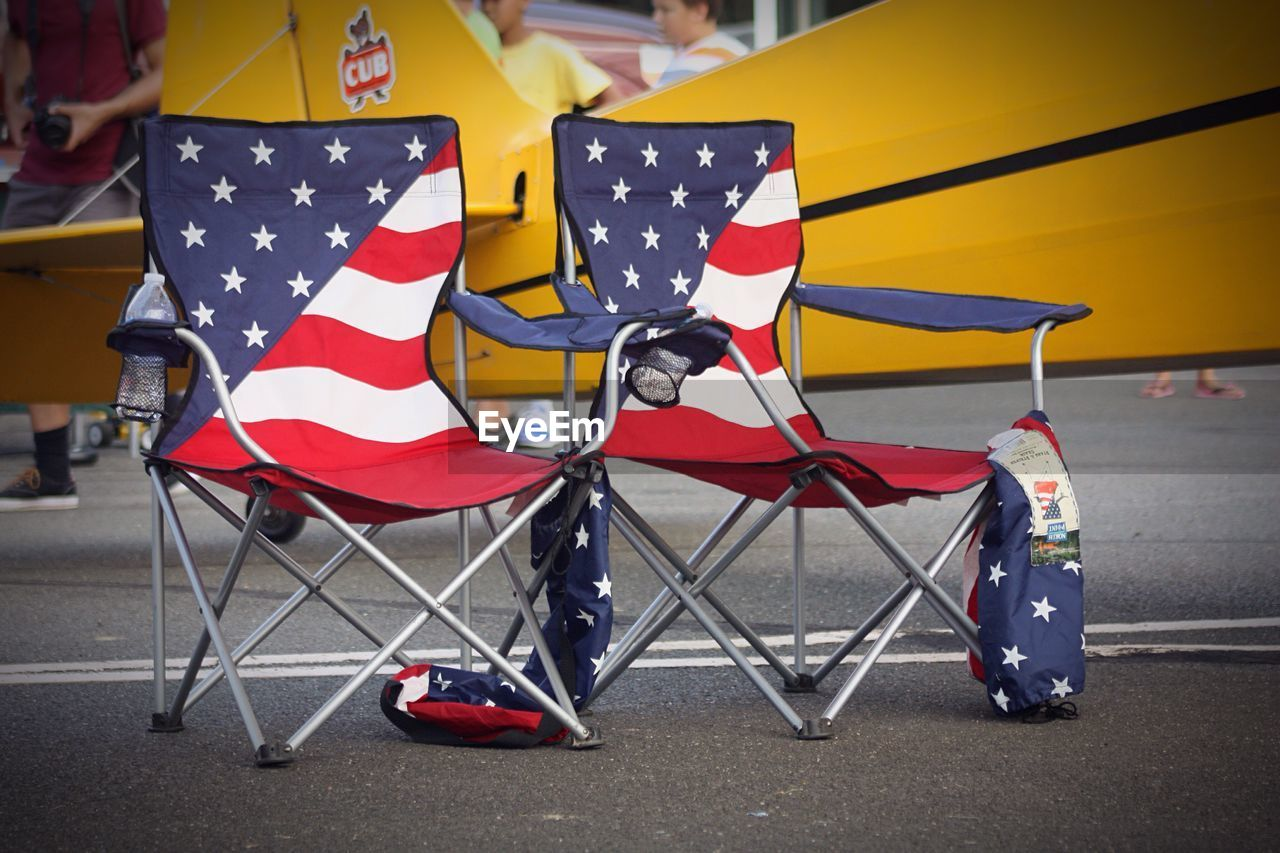 seat, chair, red, table, pattern, no people, focus on foreground, day, close-up, transportation, outdoors, polka dot, star shape, flag, security, protection, striped, absence, shoe, shape