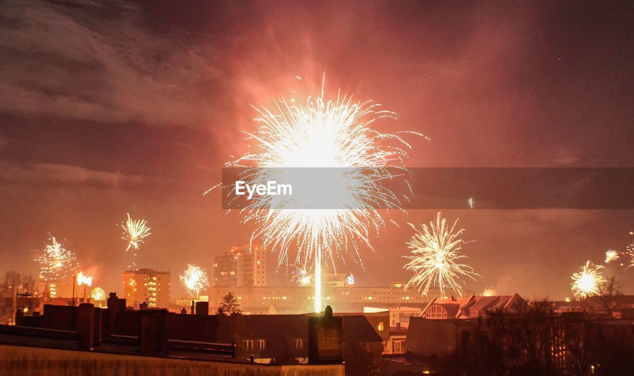 firework, night, celebration, motion, event, illuminated, architecture, building exterior, arts culture and entertainment, sky, built structure, firework display, glowing, exploding, no people, long exposure, nature, city, light, outdoors, firework - man made object, sparks