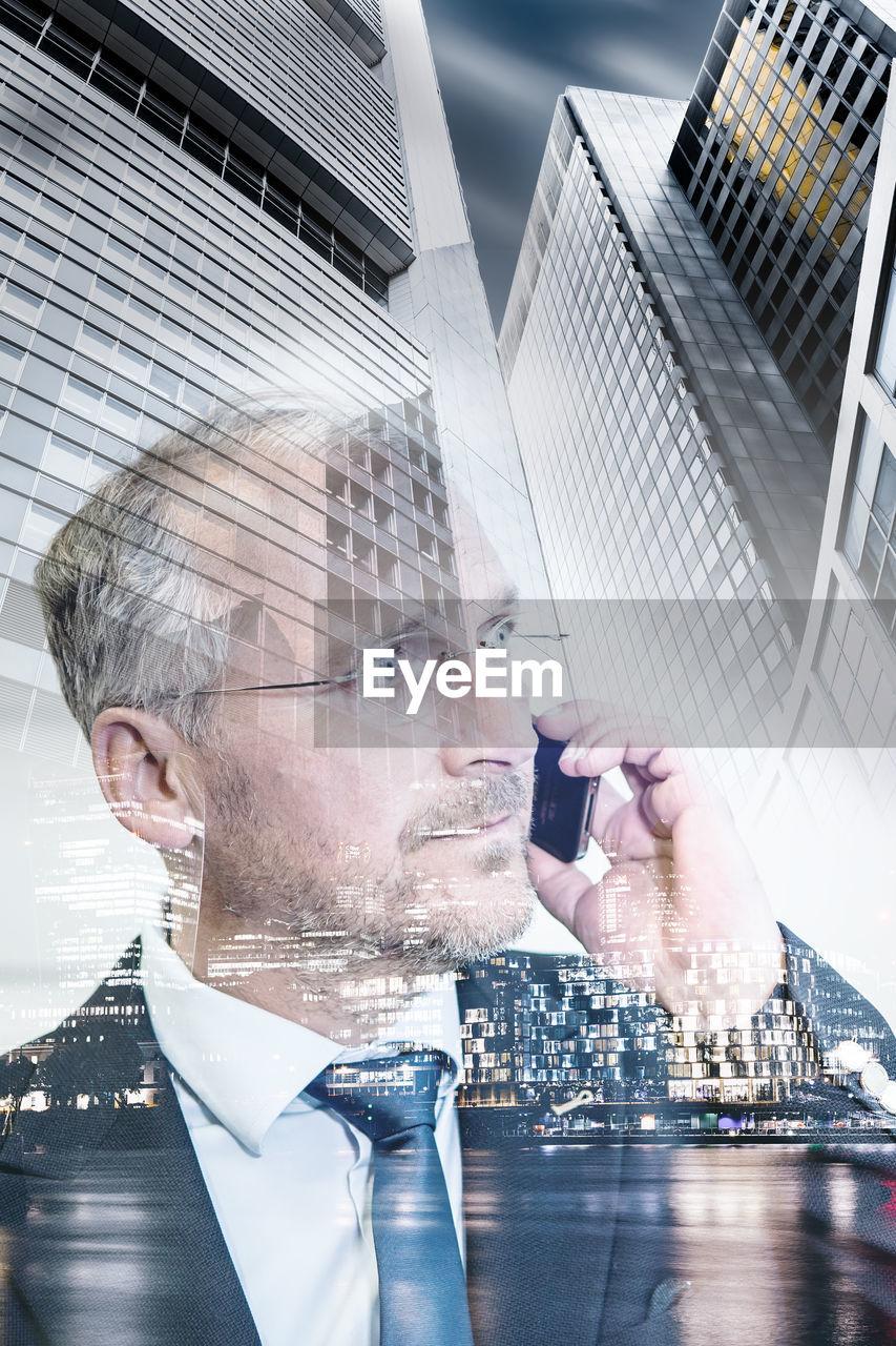 Close-up of businessman using smart phone