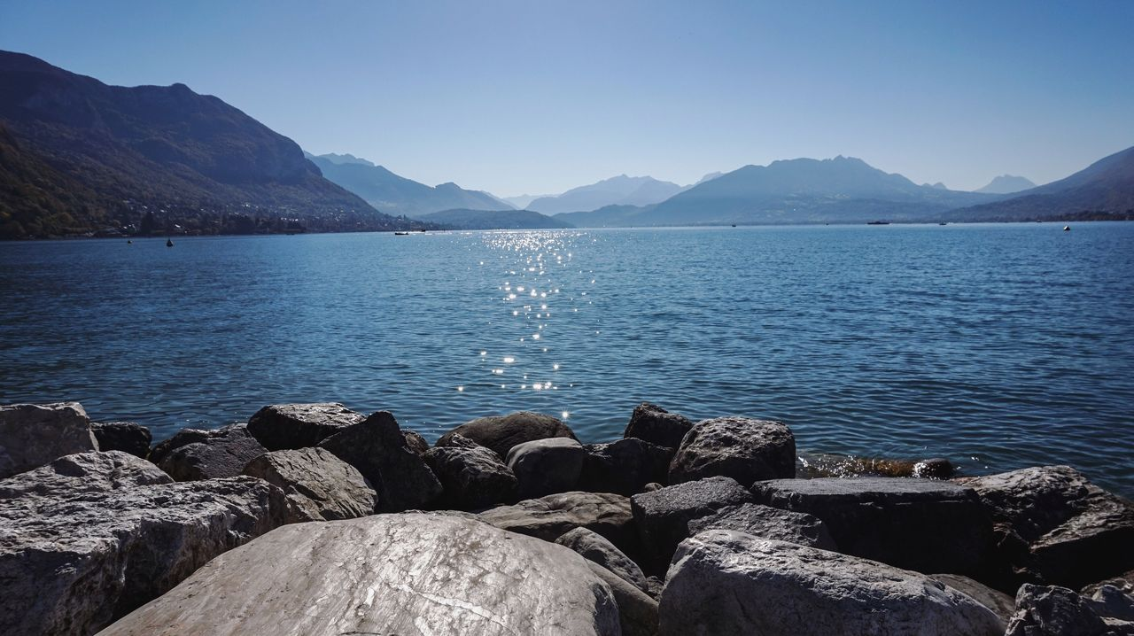 water, mountain, nature, tranquility, tranquil scene, scenics, beauty in nature, lake, no people, rock - object, outdoors, day, clear sky, mountain range, blue, sky