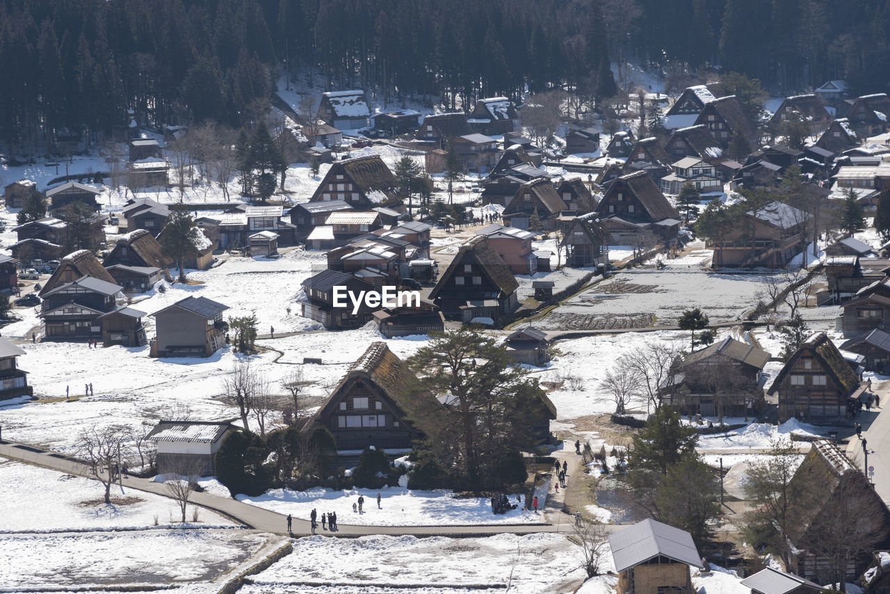 HIGH ANGLE VIEW OF TOWNSCAPE AND SNOW COVERED LANDSCAPE