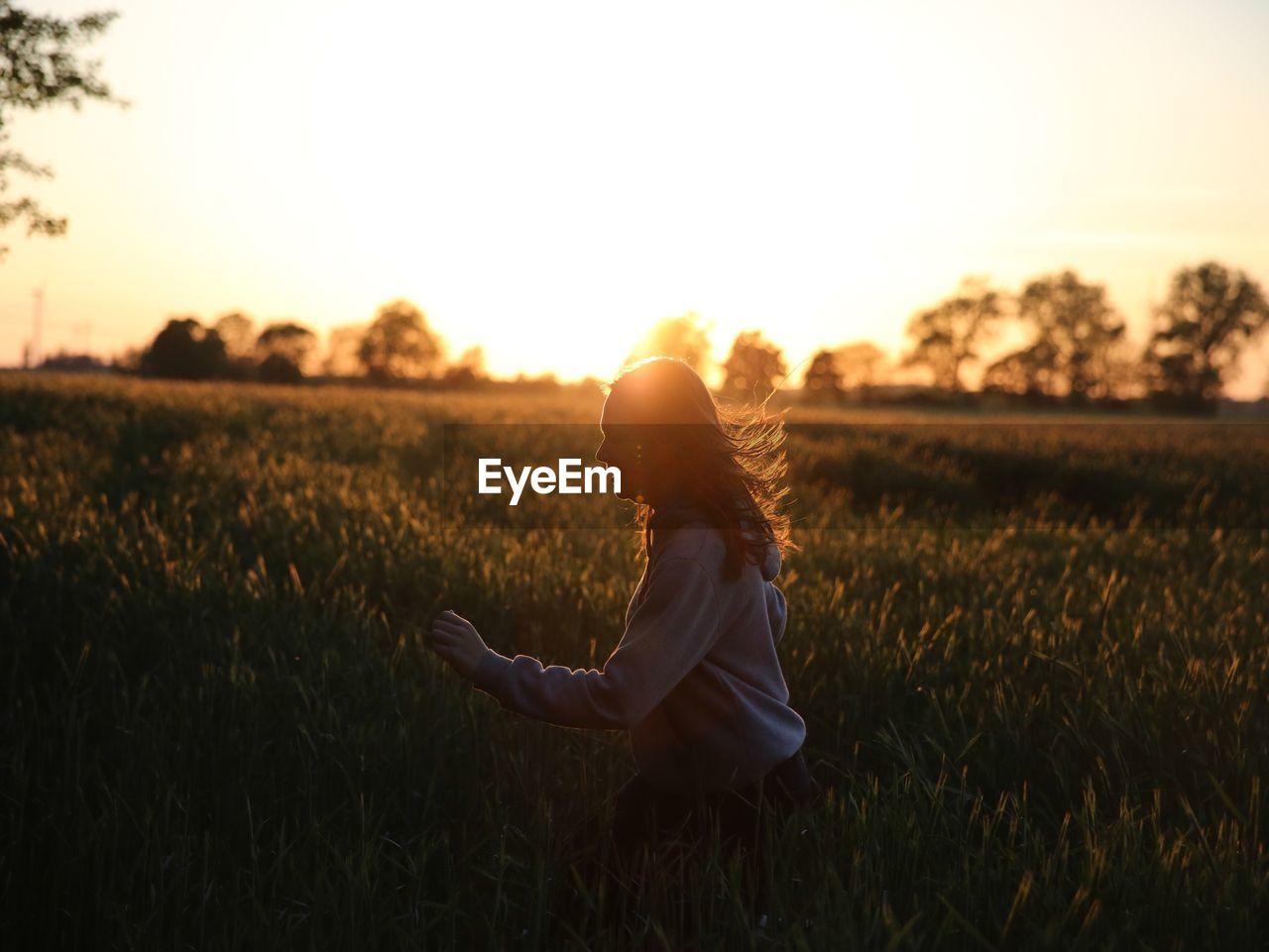 Side View Of A Woman In Field