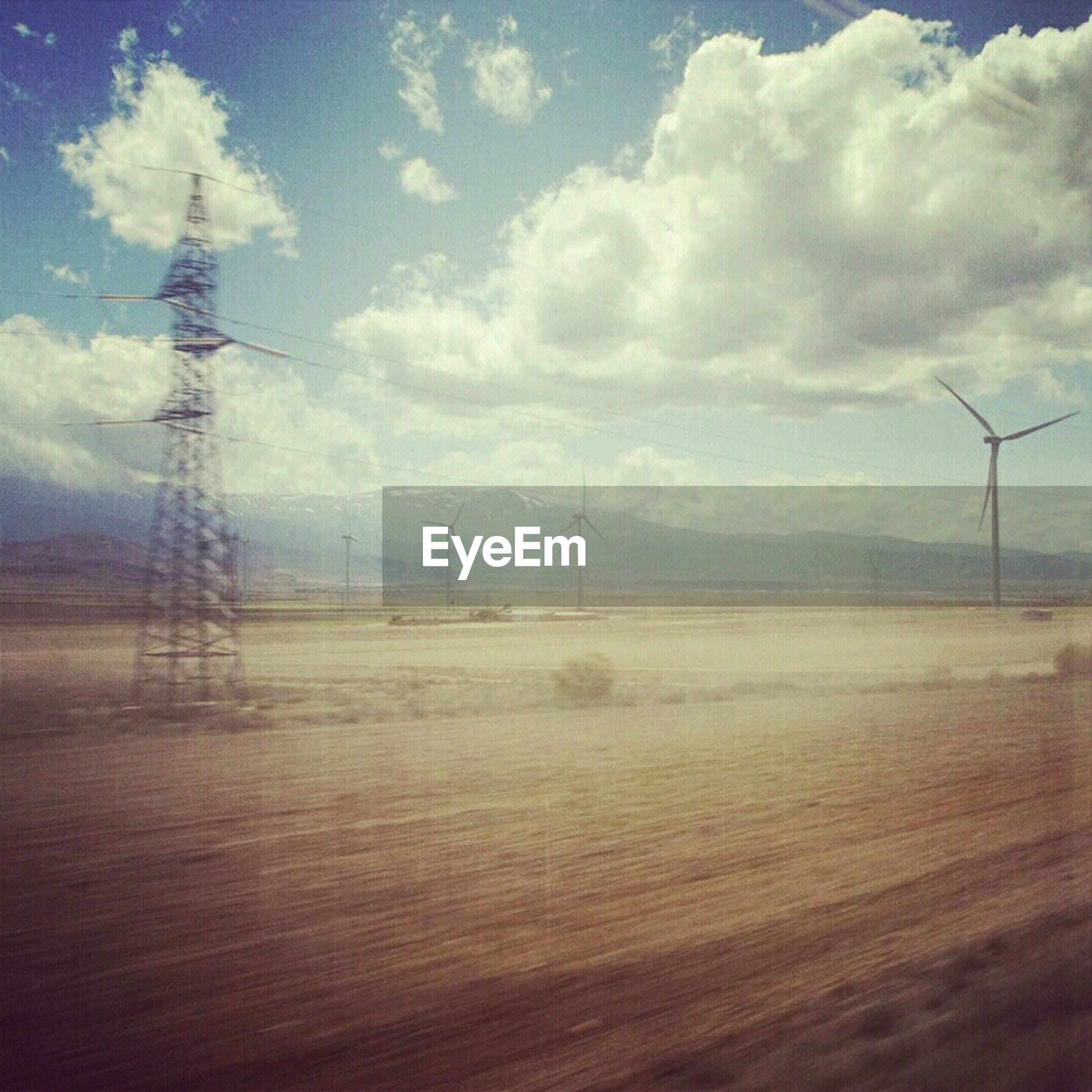 fuel and power generation, electricity pylon, sky, electricity, tranquility, tranquil scene, power supply, technology, power line, landscape, scenics, cloud - sky, nature, wind turbine, beauty in nature, connection, alternative energy, wind power, environmental conservation, cloudy
