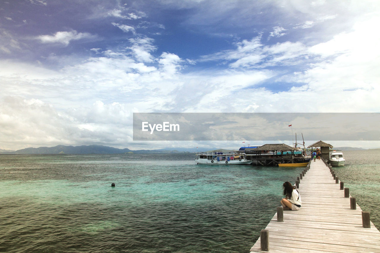 water, sky, cloud - sky, sea, nature, transportation, pier, nautical vessel, scenics - nature, day, holiday, beauty in nature, vacations, mode of transportation, trip, travel, incidental people, beach, real people, outdoors