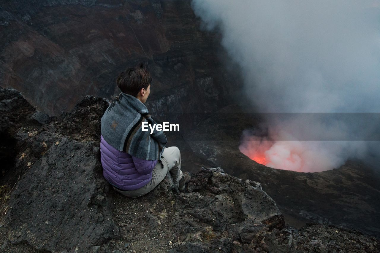 Woman Looking At Volcano