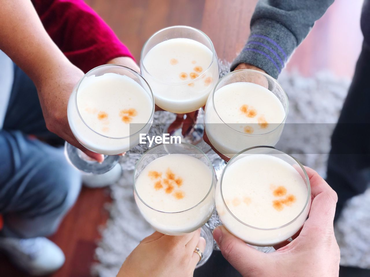 High Angle View Of People Holding Toasting Drinks