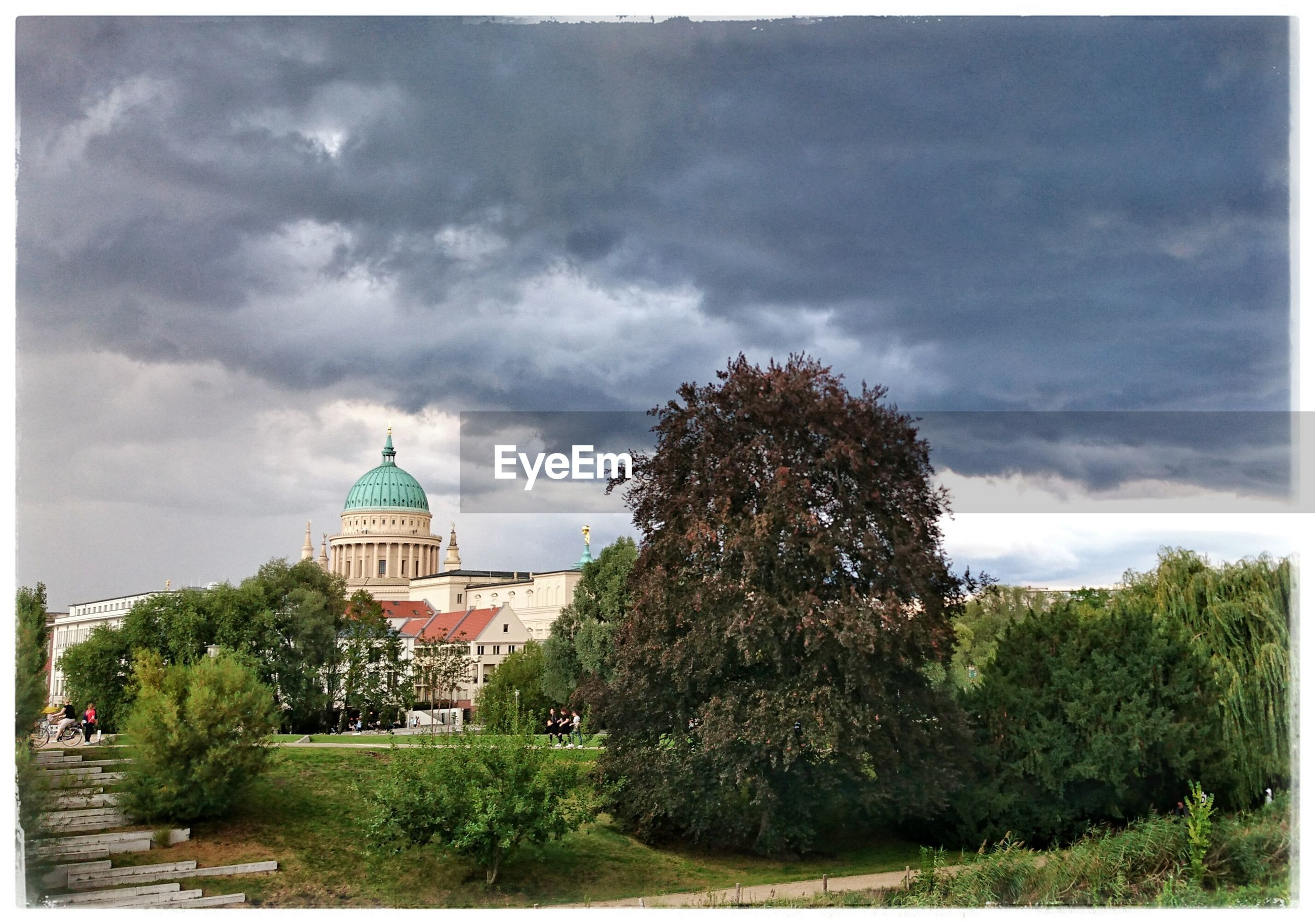 tree, architecture, built structure, building exterior, sky, cloud - sky, auto post production filter, religion, cloudy, plant, growth, cloud, dome, outdoors, church, travel destinations, place of worship, nature, storm cloud, tranquil scene, day, tranquility, history, spire, scenics, lawn, the past, garden, formal garden