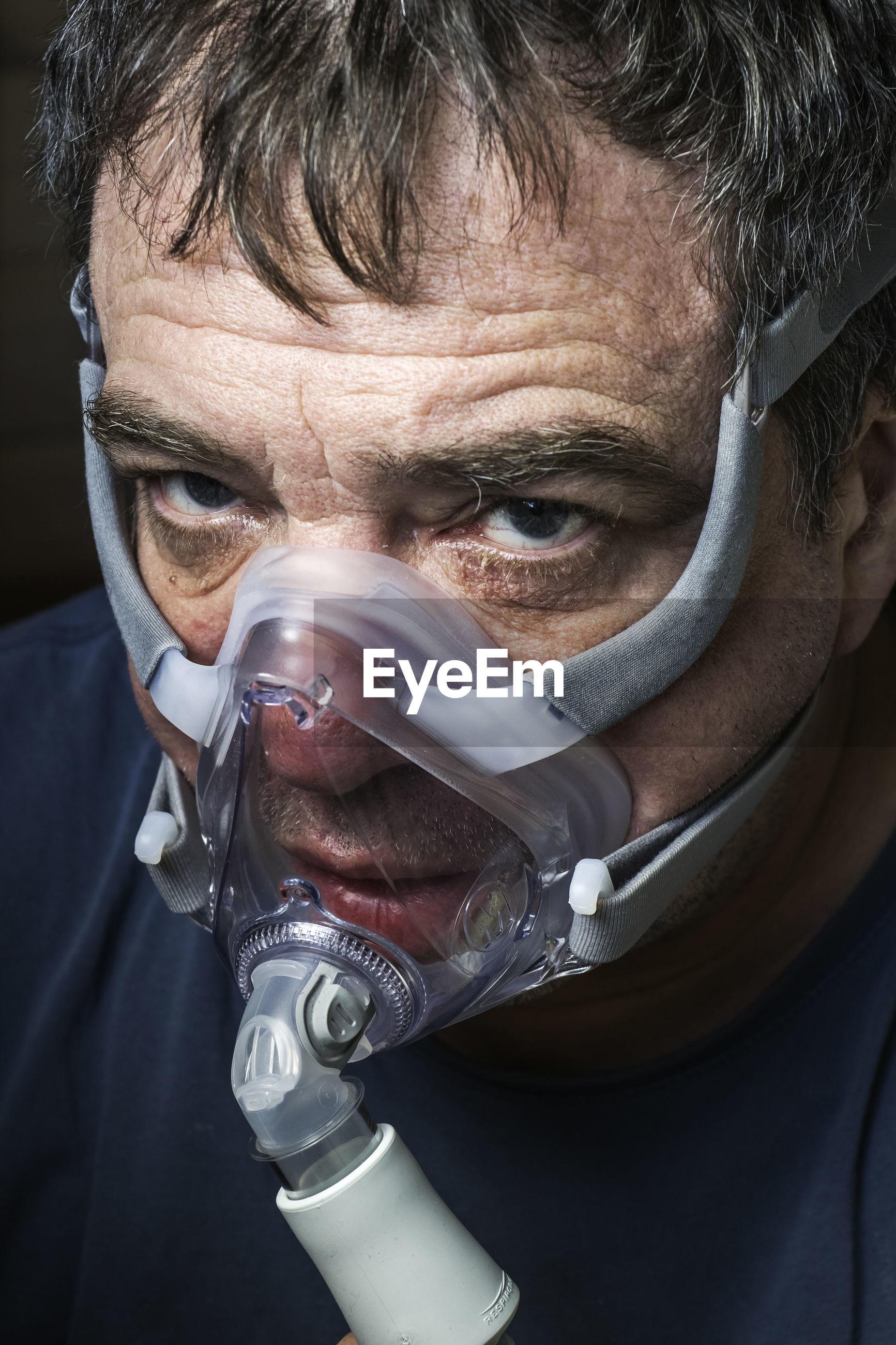 Coronavirus patient male in oxygen mask