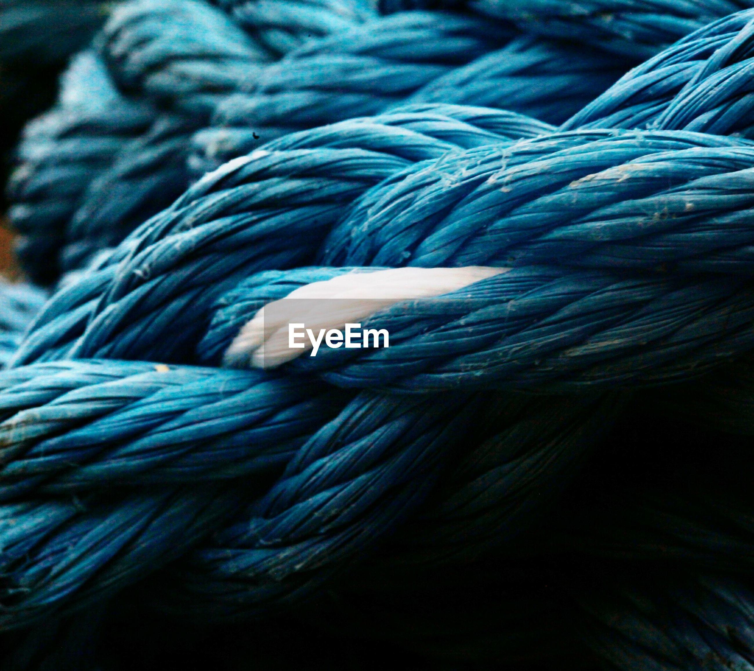 Full frame shot of blue ropes at harbor