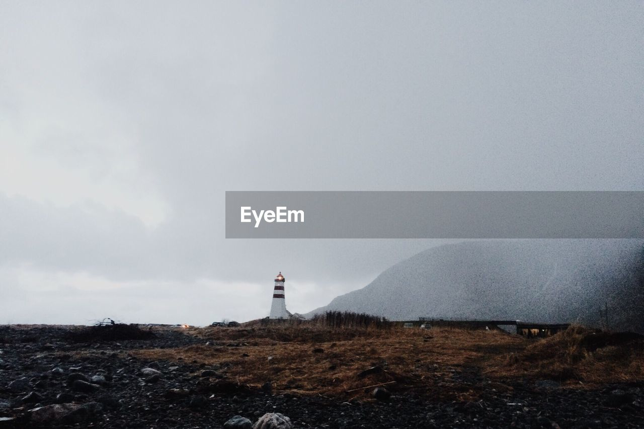 Distant View Of Lighthouse Against Sky