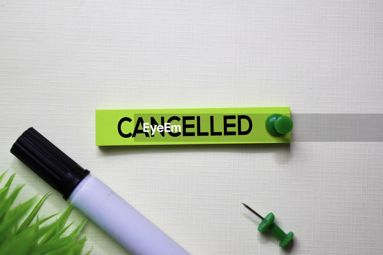 indoors, green color, still life, communication, pen, no people, close-up, table, text, paper, yellow, writing instrument, western script, white background, studio shot, education, pencil, office supply, page, adhesive note, art and craft equipment