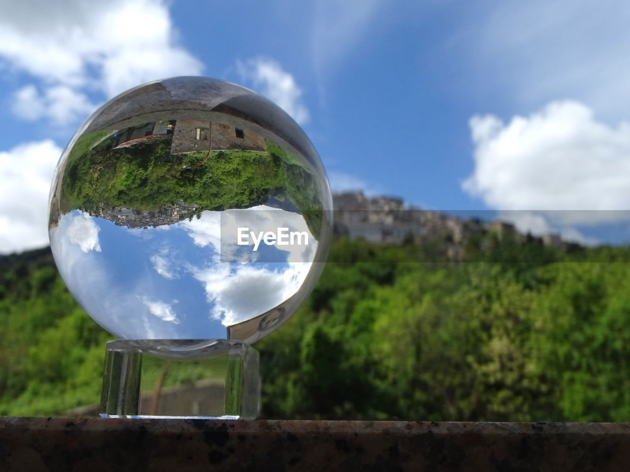 sky, cloud - sky, sphere, nature, focus on foreground, glass - material, transparent, day, reflection, no people, close-up, outdoors, plant, tree, shape, geometric shape, ball, environment, circle, crystal ball
