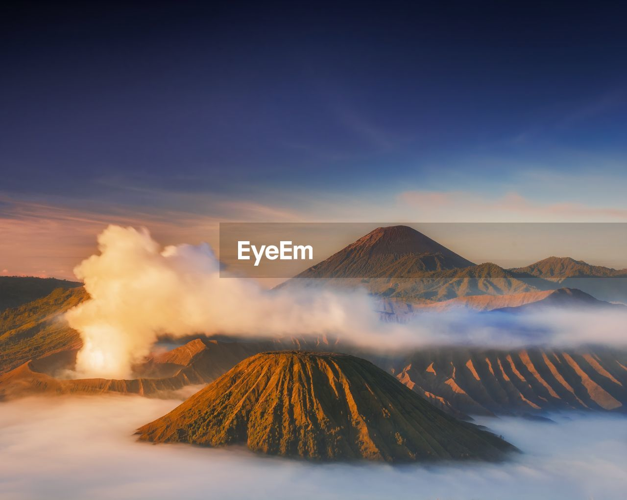 mountain, scenics - nature, sky, beauty in nature, volcano, cloud - sky, tranquil scene, smoke - physical structure, non-urban scene, no people, idyllic, geology, tranquility, nature, mountain range, environment, outdoors, travel destinations, active volcano, physical geography, volcanic crater, power in nature, mountain peak, pollution