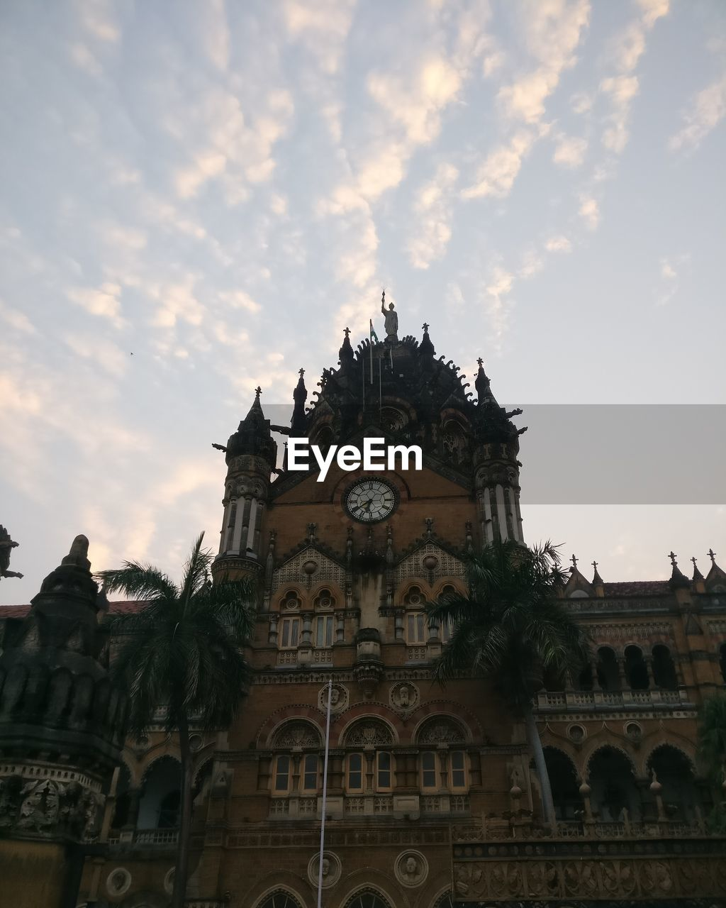 building exterior, built structure, architecture, sky, low angle view, building, cloud - sky, travel destinations, history, travel, no people, the past, tourism, clock, sunset, nature, place of worship, belief, time, clock tower, outdoors, ornate, gothic style