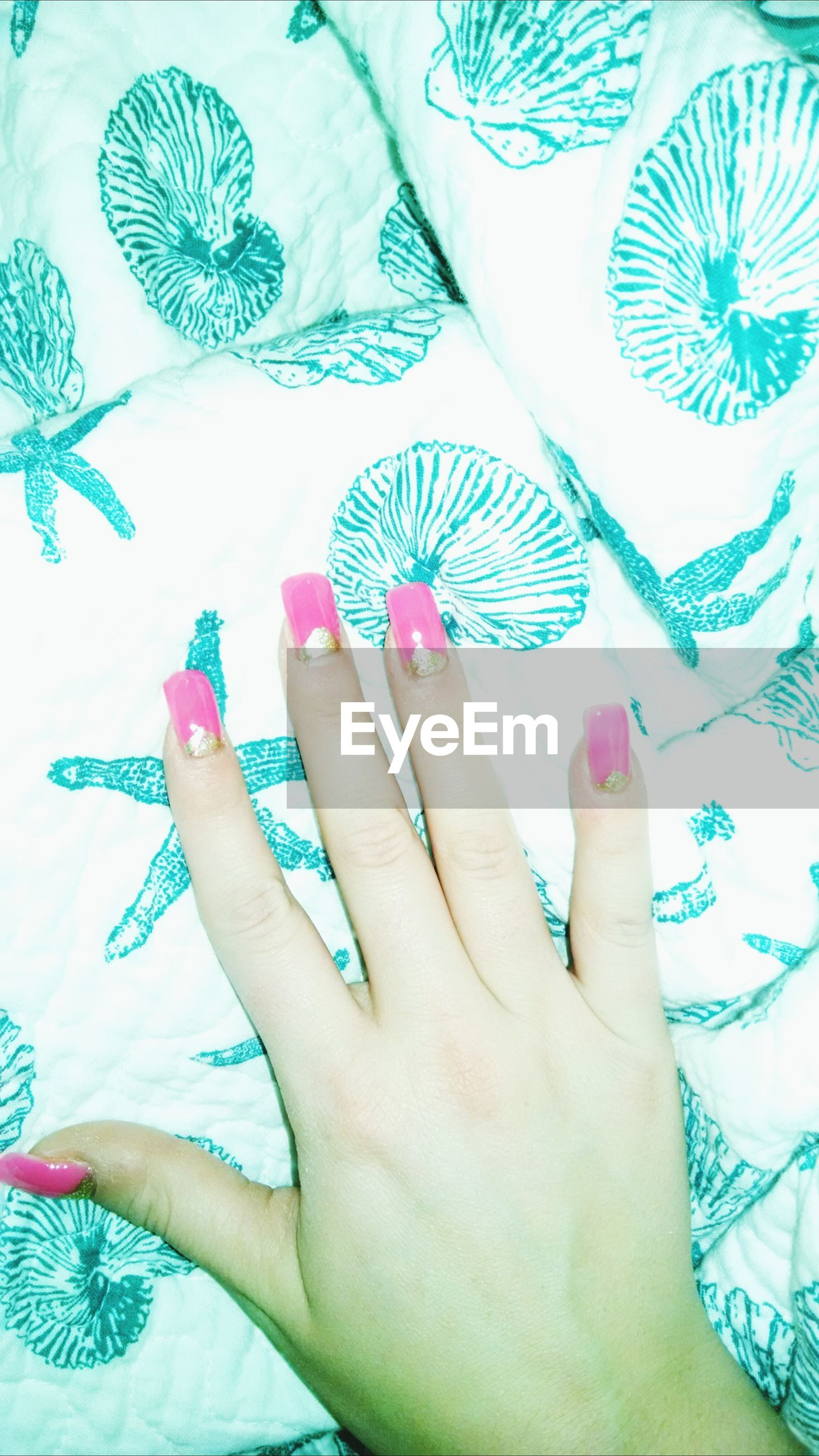 person, indoors, part of, cropped, creativity, holding, human finger, art and craft, art, high angle view, paper, close-up, multi colored, lifestyles, table, floral pattern