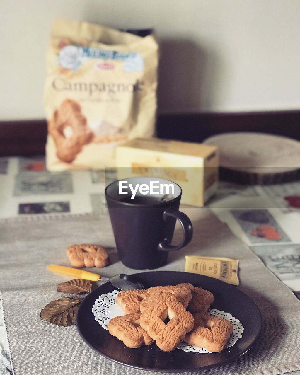 food and drink, cup, mug, drink, coffee cup, food, baked, table, refreshment, coffee, coffee - drink, indoors, cookie, still life, freshness, text, no people, focus on foreground, close-up, western script, crockery, snack, breakfast, non-alcoholic beverage, temptation