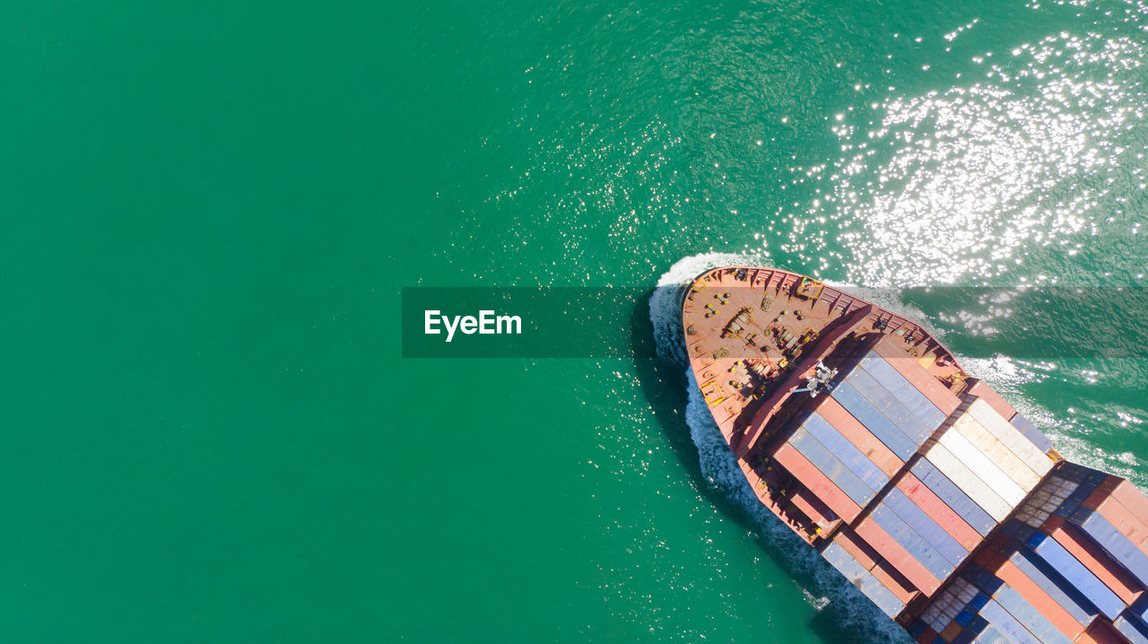 water, sea, nautical vessel, high angle view, nature, transportation, day, no people, mode of transportation, ship, aerial view, green color, turquoise colored, outdoors, beauty in nature, travel, motion, waterfront, copy space, passenger craft, above
