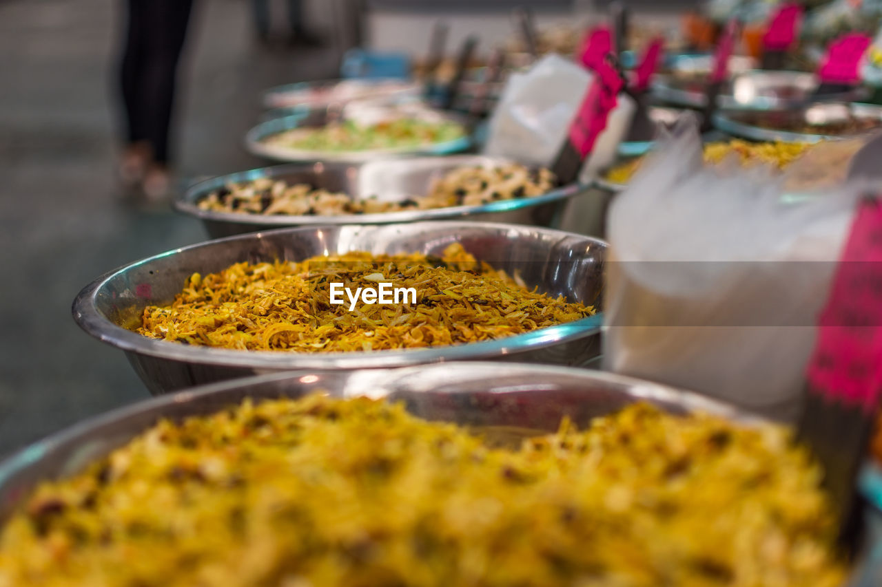 Close-Up Of Spices In Containers At Market Stall