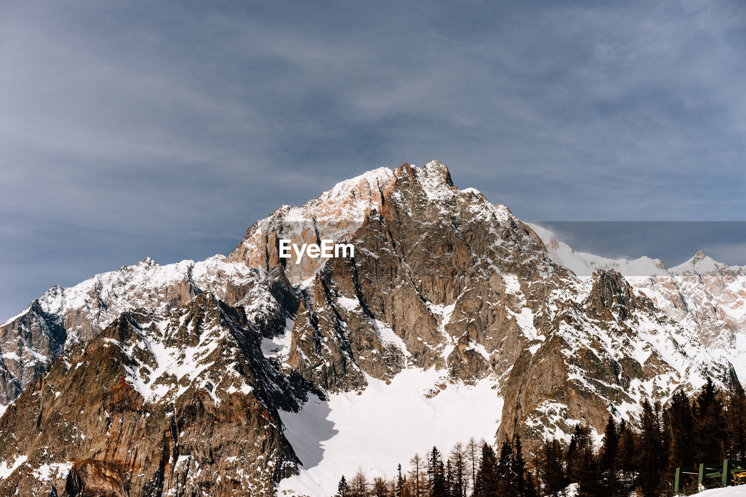 LOW ANGLE VIEW OF SNOWCAPPED MOUNTAIN AGAINST SKY DURING WINTER