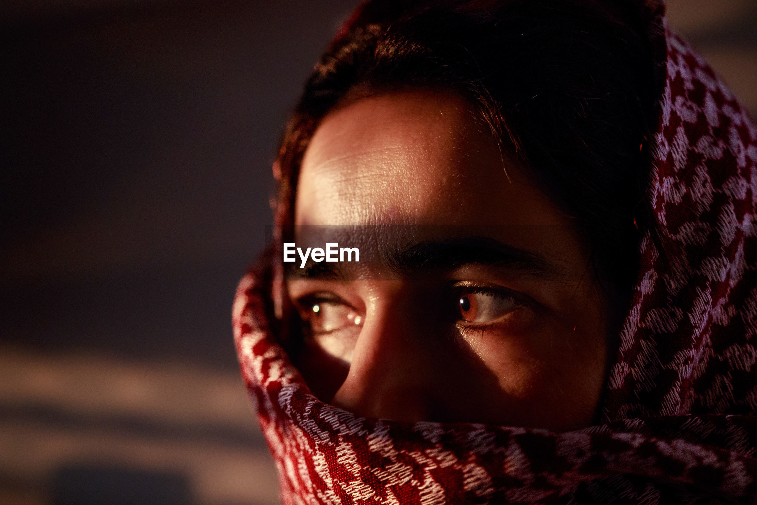 Portrait of a desert girl with fantastic brown eyes