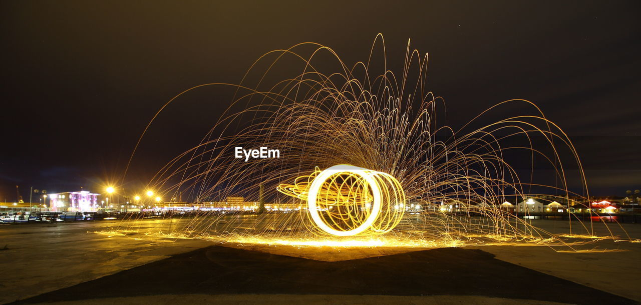 night, illuminated, motion, long exposure, glowing, blurred motion, wire wool, sky, water, city, nature, built structure, architecture, spinning, light painting, speed, sparks, light - natural phenomenon, light trail, outdoors, no people, light