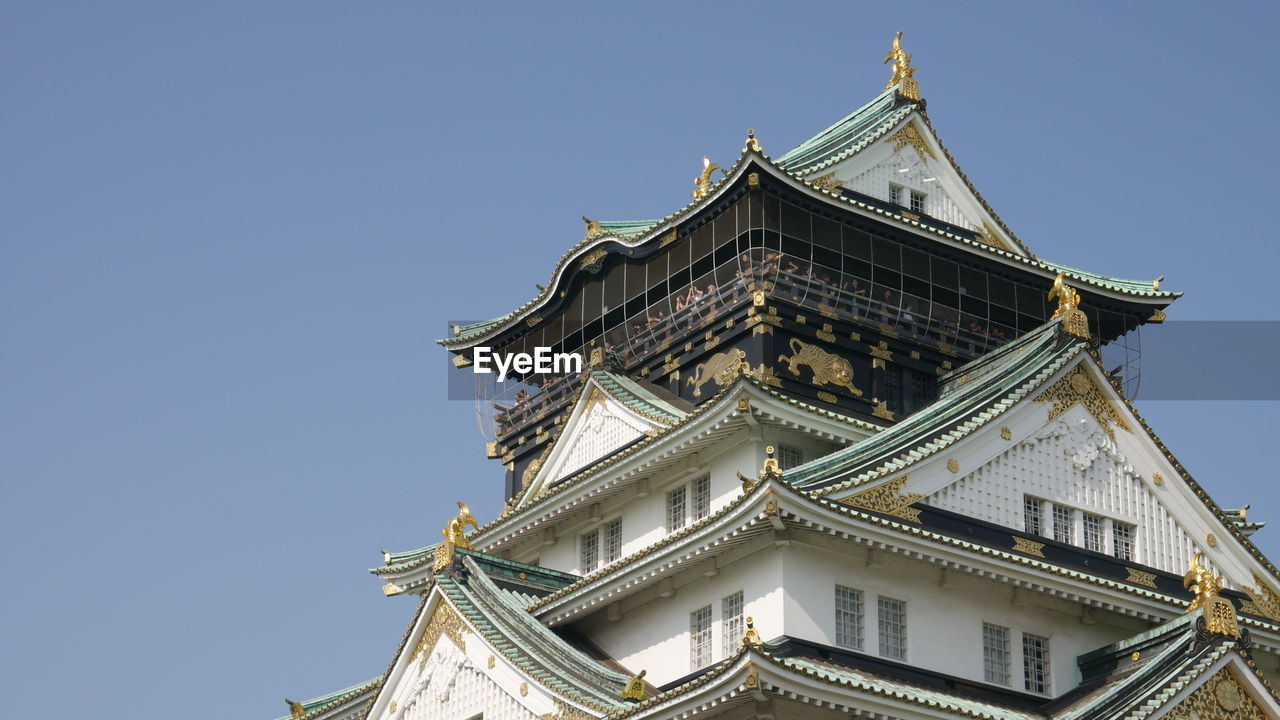 Low angle view of osaka castle against clear sky