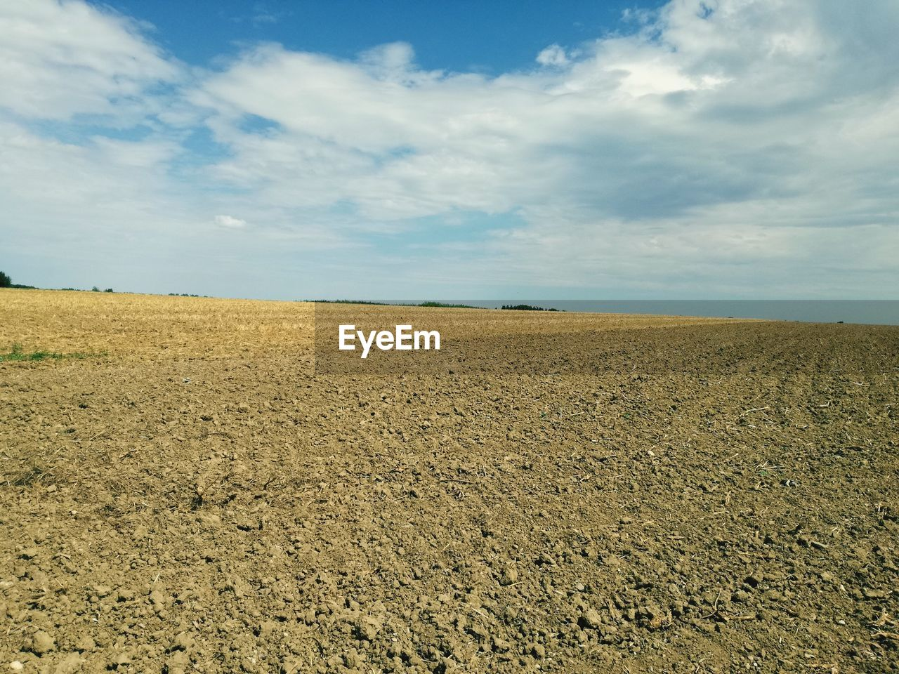 sky, environment, cloud - sky, land, landscape, tranquil scene, field, tranquility, scenics - nature, beauty in nature, nature, no people, rural scene, agriculture, day, horizon over land, horizon, idyllic, non-urban scene, outdoors, arid climate