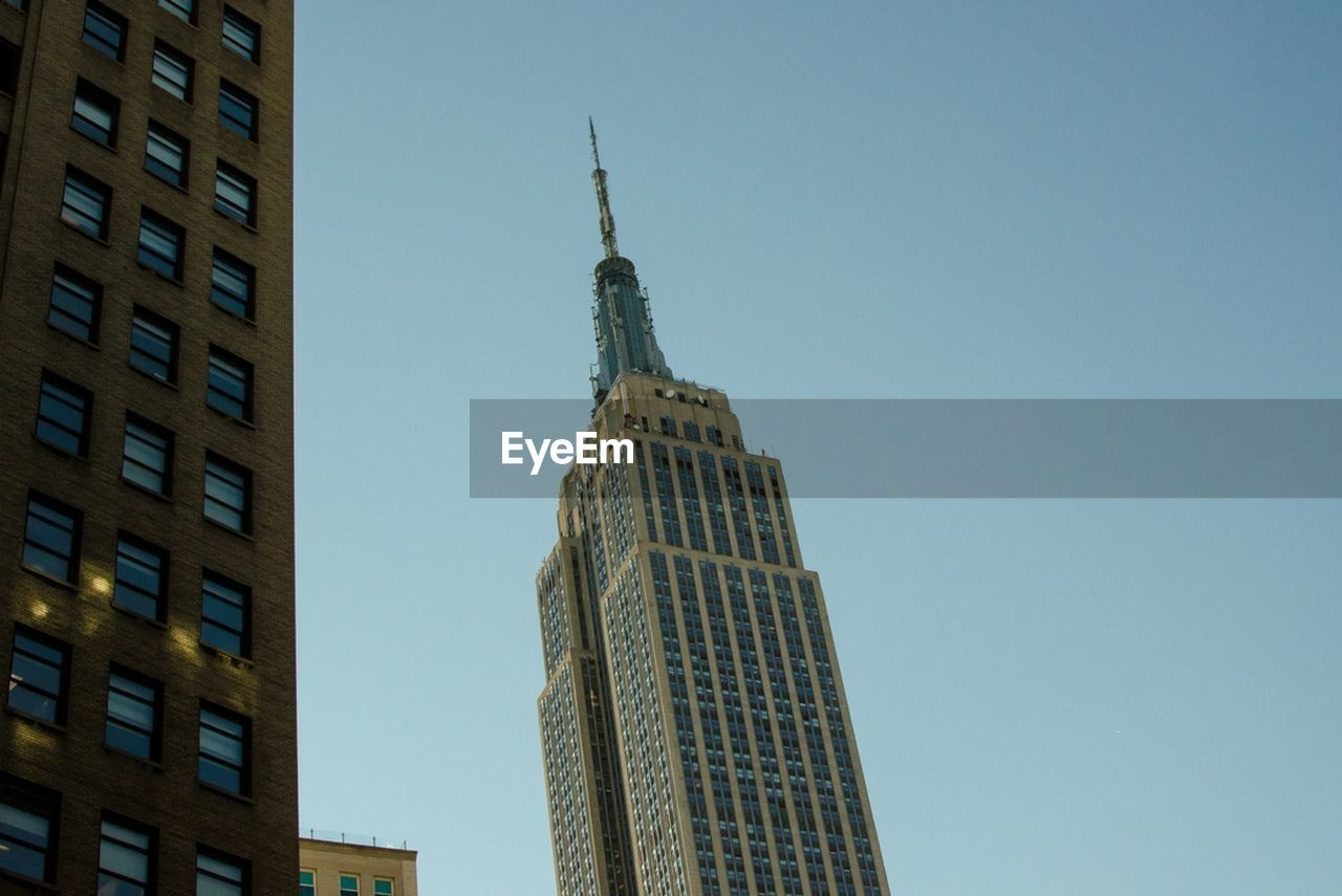 architecture, skyscraper, low angle view, built structure, modern, building exterior, tower, city, tall, clear sky, no people, outdoors, day, sky