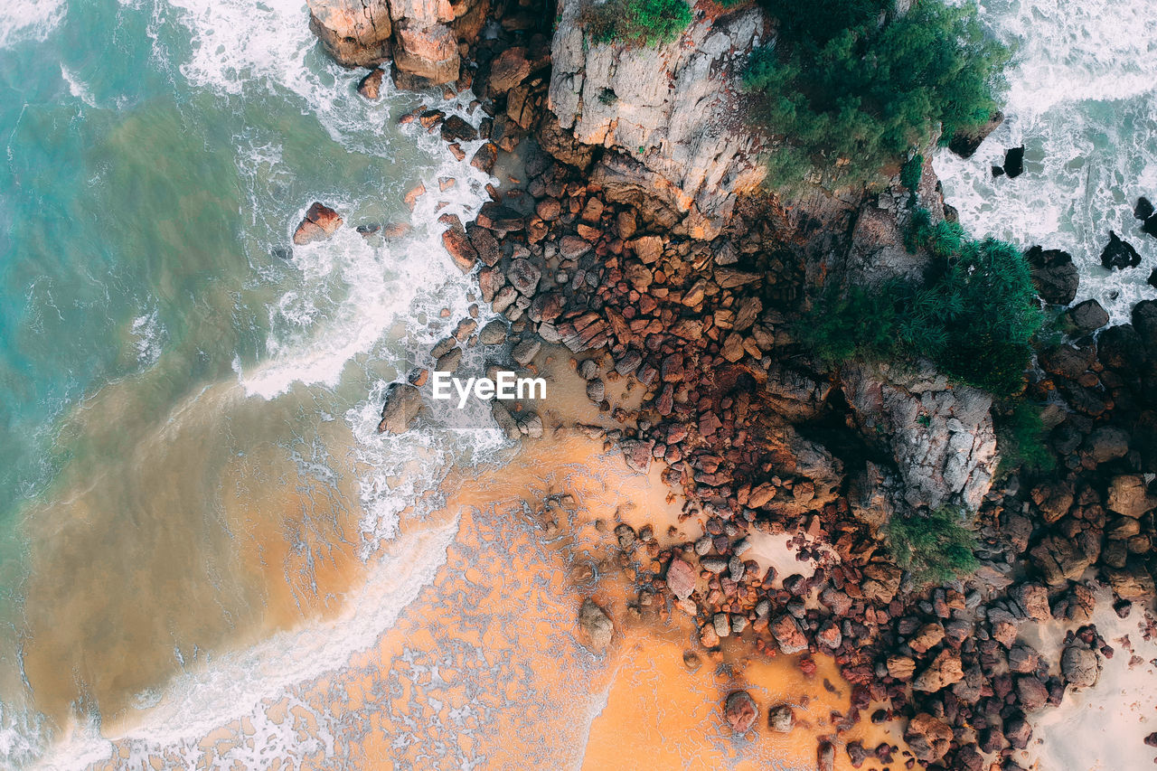 water, solid, sea, rock, rock - object, nature, beauty in nature, no people, day, high angle view, land, motion, outdoors, beach, aerial view, scenics - nature, tranquility, multi colored, power in nature