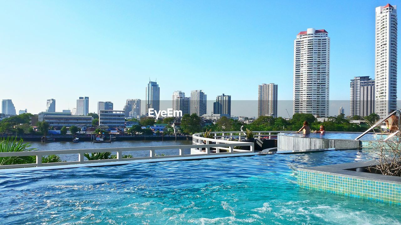 Swimming Pool In Hotel Against Cityscape