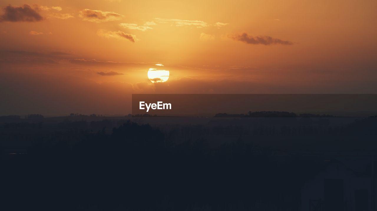 sky, sunset, beauty in nature, orange color, scenics - nature, silhouette, tranquility, no people, tranquil scene, cloud - sky, nature, idyllic, sun, landscape, environment, outdoors, sunlight, built structure, building exterior, non-urban scene, romantic sky