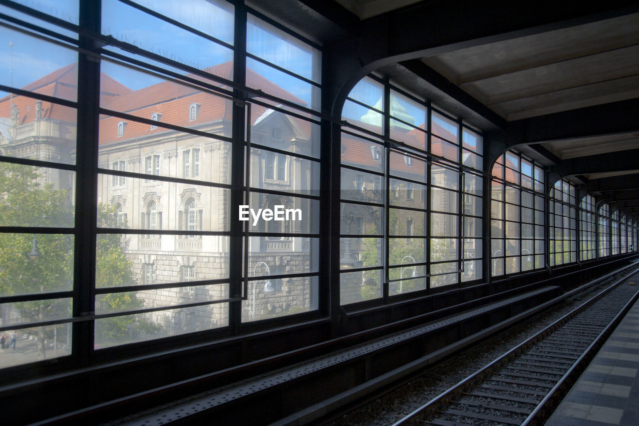window, rail transportation, track, glass - material, railroad track, indoors, transportation, transparent, architecture, no people, mode of transportation, railroad station, public transportation, day, built structure, railroad station platform, nature, travel, glass, station
