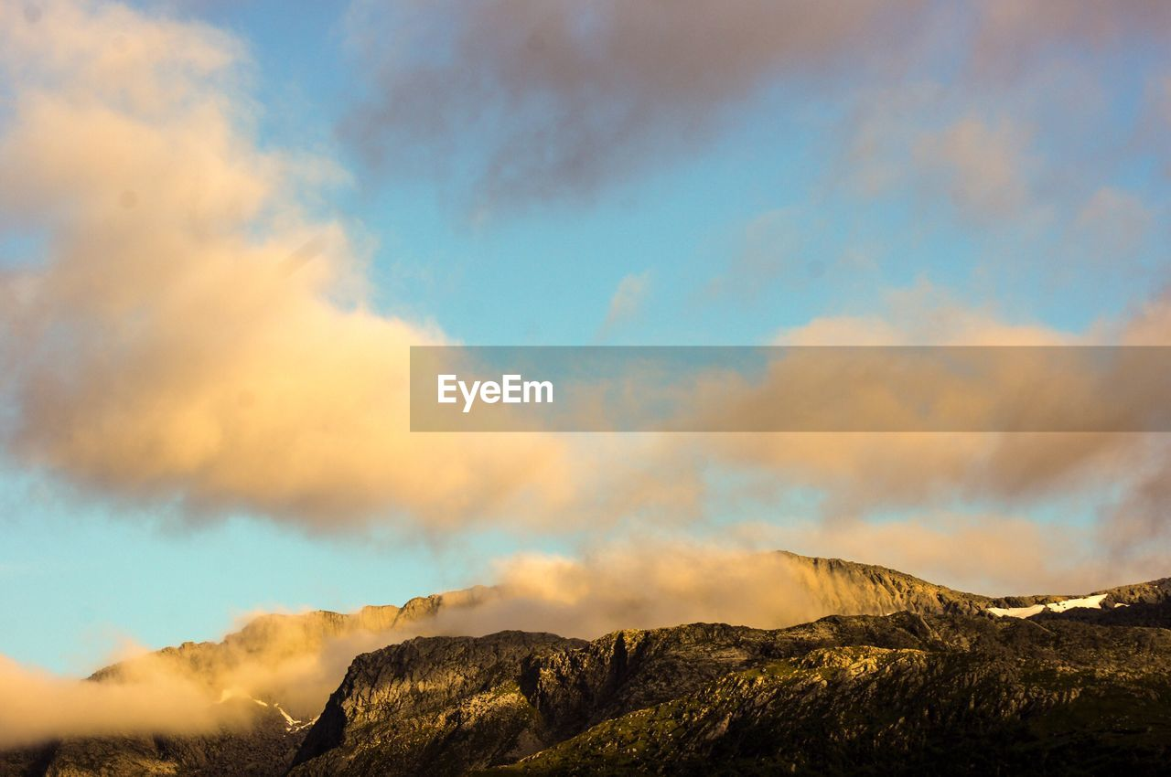 cloud - sky, sky, mountain, beauty in nature, scenics - nature, tranquility, tranquil scene, nature, non-urban scene, mountain range, no people, environment, sunset, day, low angle view, outdoors, idyllic, landscape, remote, mountain peak, formation