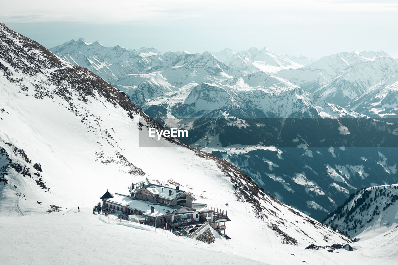 snow, winter, cold temperature, mountain, mountain range, scenics - nature, beauty in nature, snowcapped mountain, environment, day, mode of transportation, transportation, nature, sky, white color, landscape, tranquil scene, non-urban scene, tranquility, outdoors, extreme weather