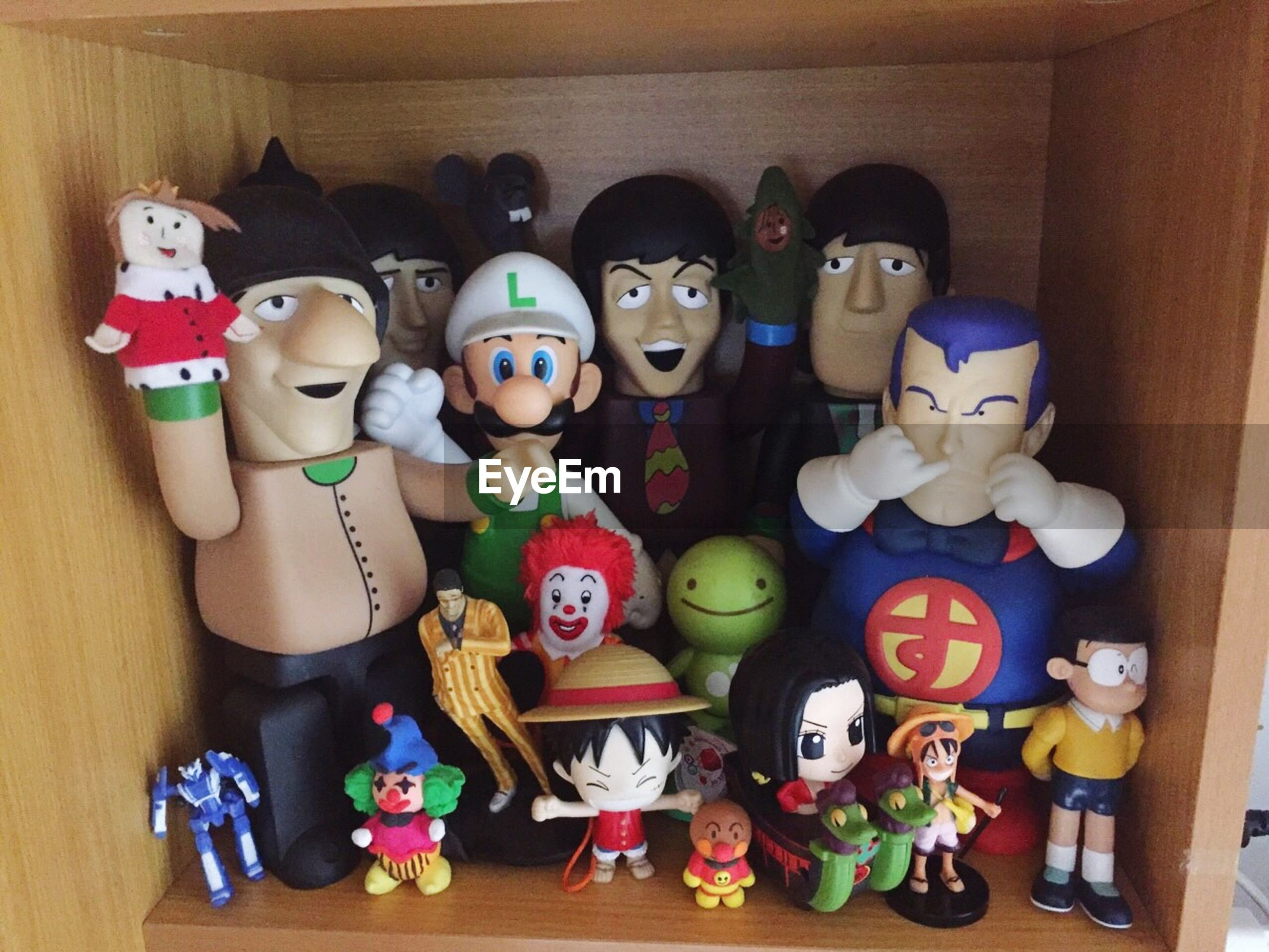 indoors, human representation, art and craft, art, toy, creativity, animal representation, multi colored, variation, large group of objects, choice, figurine, still life, childhood, arrangement, for sale, high angle view, shoe