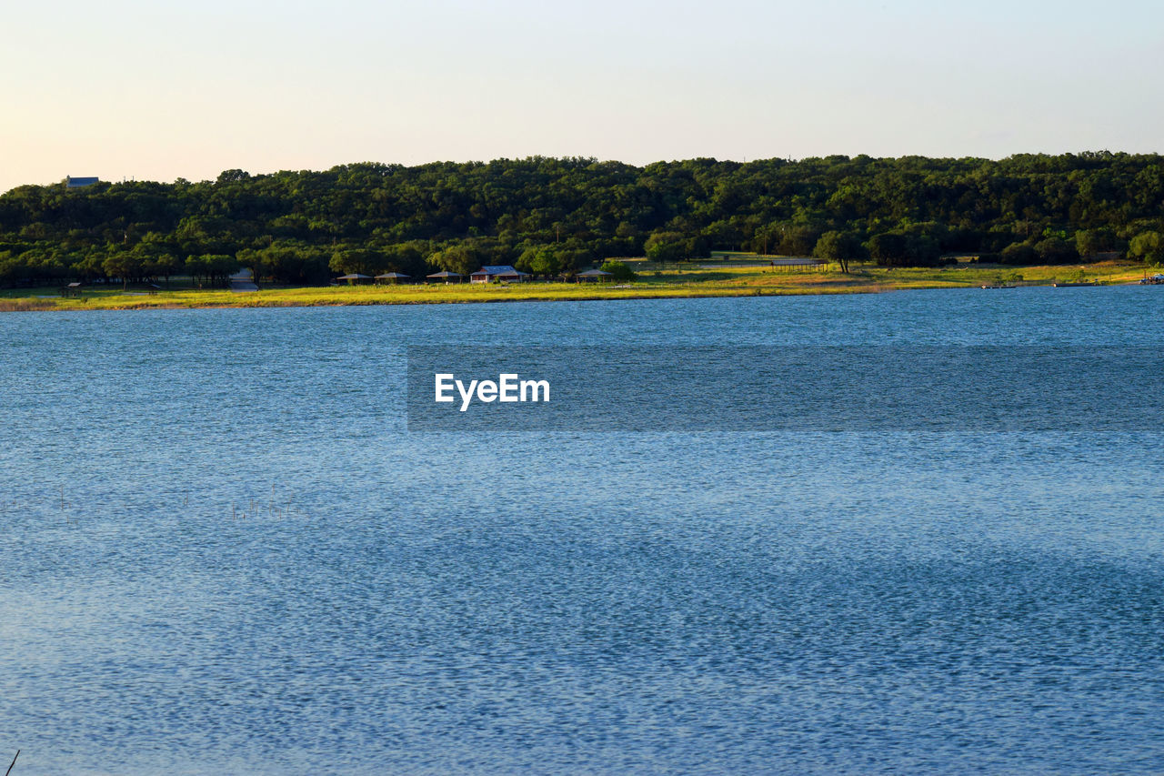 nature, beauty in nature, scenics, no people, tree, tranquil scene, water, tranquility, waterfront, outdoors, day, clear sky, landscape, sky, lake, growth